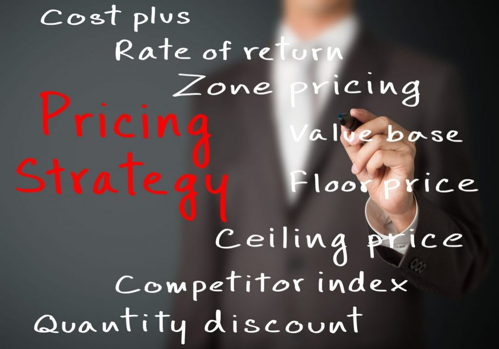25072952 - business man writing pricing strategy of marketing concept